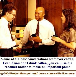 management lesson picture - three people in an office kitchen talking and holding coffee cups